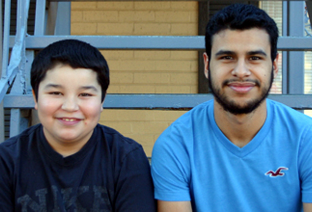 Two brothers, sitting on the steps of the apartment where their Mission Arlington church meets each Sunday.