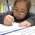 """Working on homework and learning God's word is an important part of Mission Arlington's """"after-school"""" programs."""